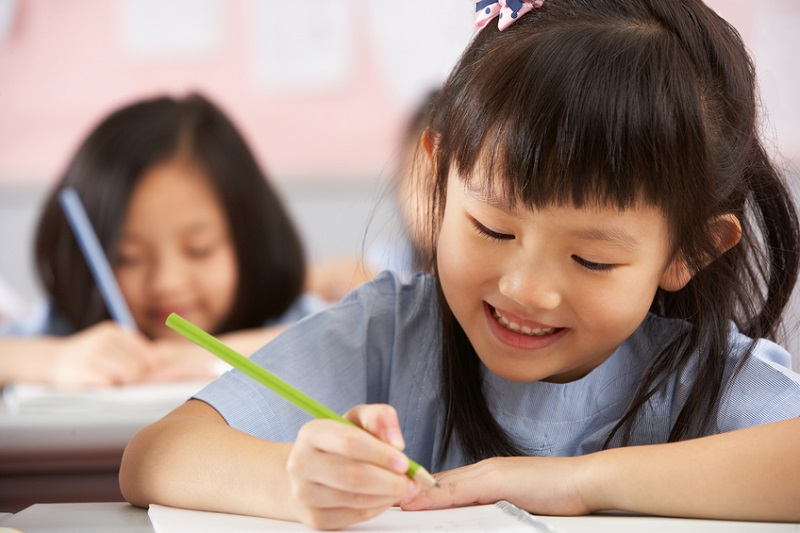 Chinese children working at desks in their classroom